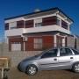 Casa de material 140 m.,3 dorm.,2 baños+casa huespédes 25 m.