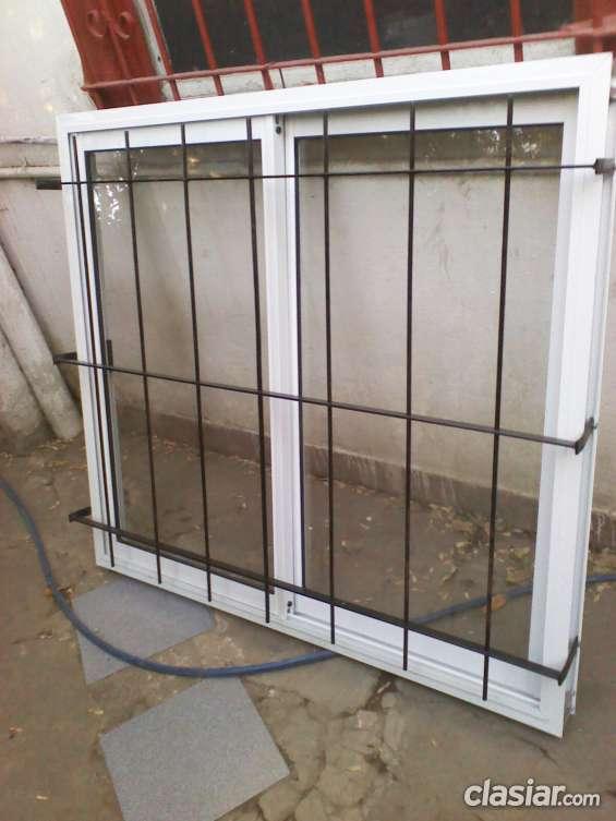 Ventanas de aluminio con rejas nuevas de 120x110 zona ezeiza